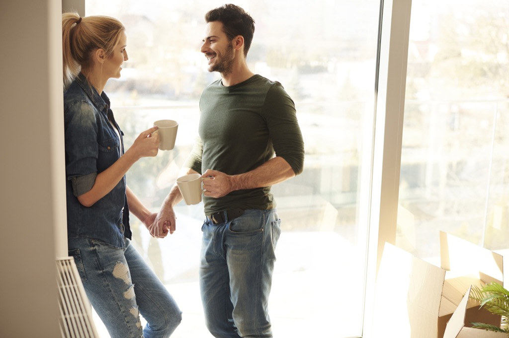 couple looking at each other with coffee - being single
