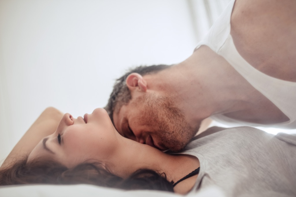 kissing foreplay lovers bed