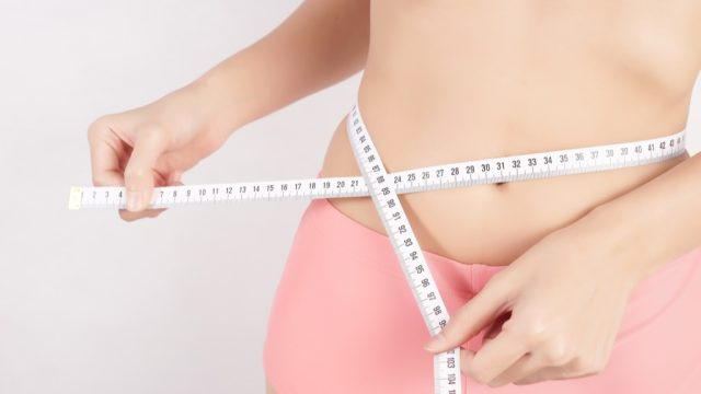 woman measuring tape weight loss