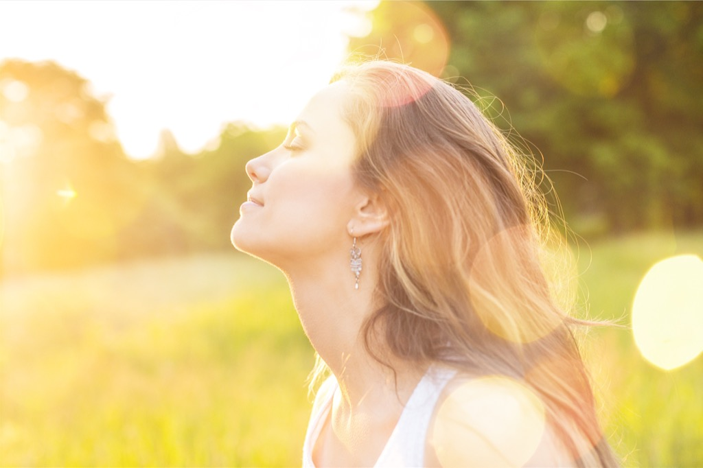 Woman in the sun representing light therapy, something great for your body clock.