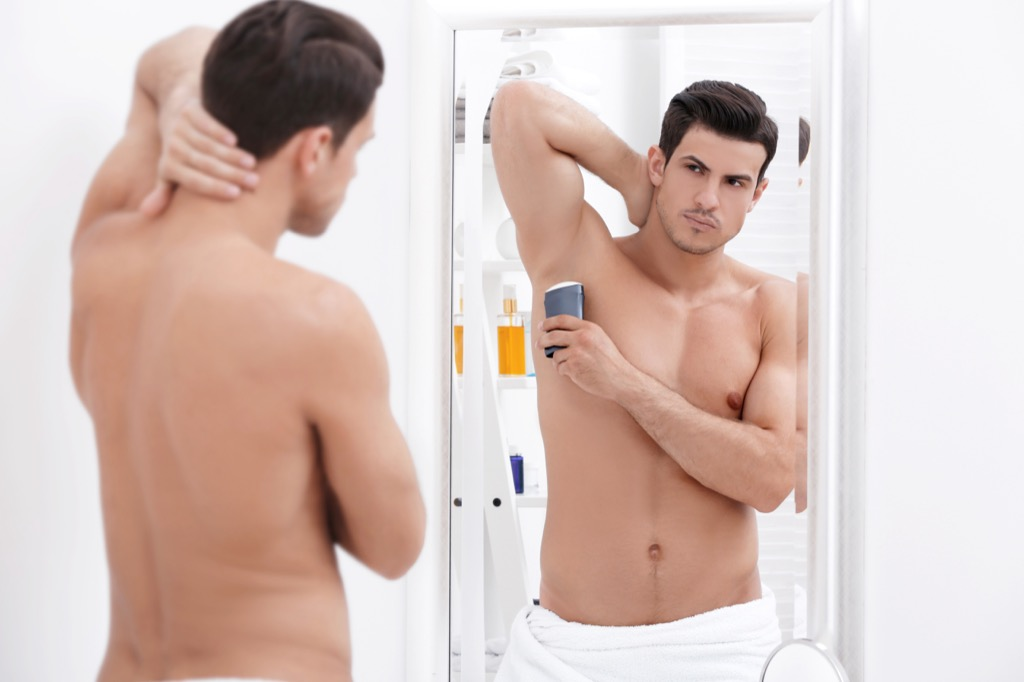 Man Putting on Deodorant Things You Believed That Aren't True