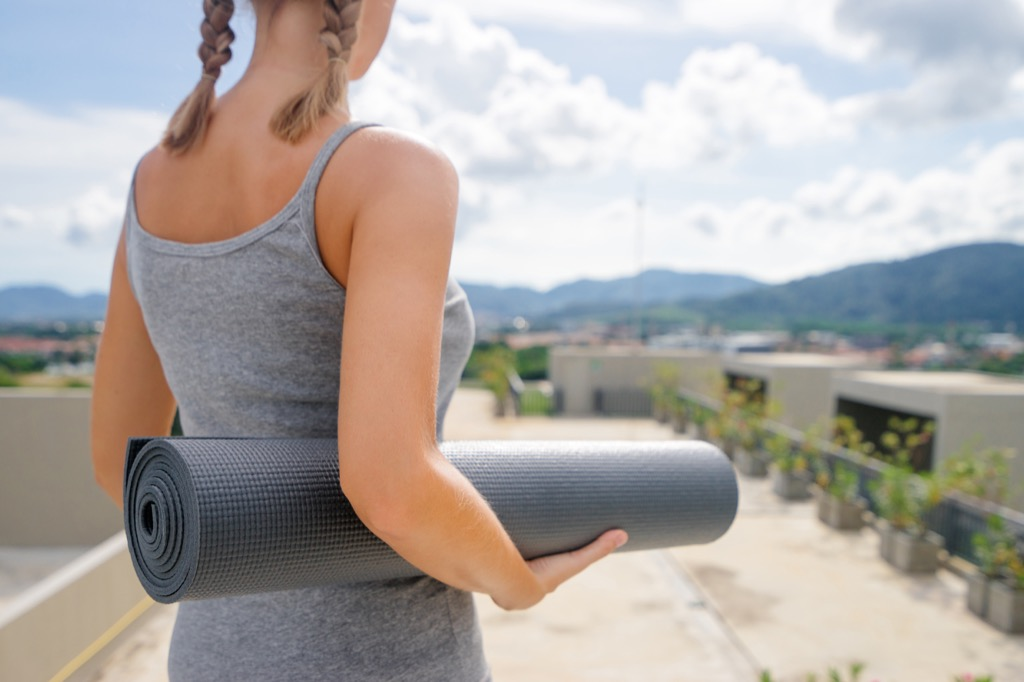 woman doing yoga outside, weight loss motivation