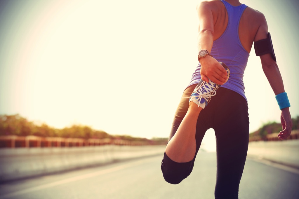 woman running run stretching exercise lies over 40