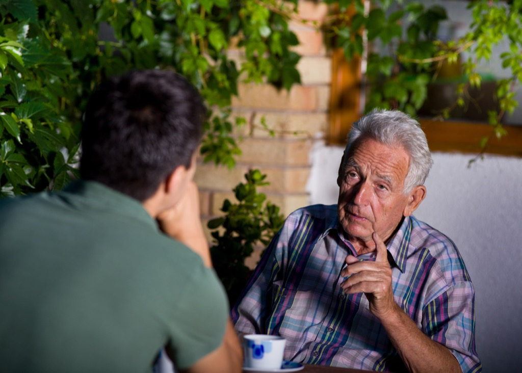young man talking to old man conversationalist