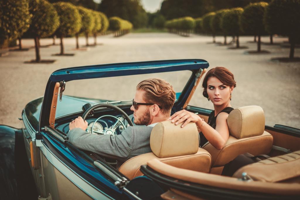 billionaires under 40 rich couple driving a car
