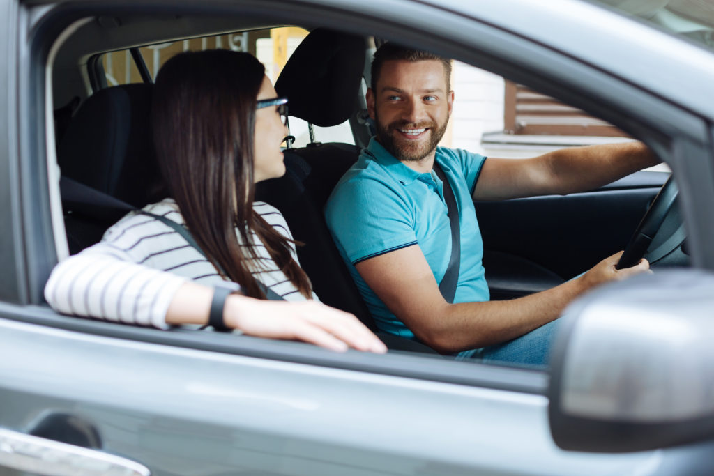 Man and woman driving