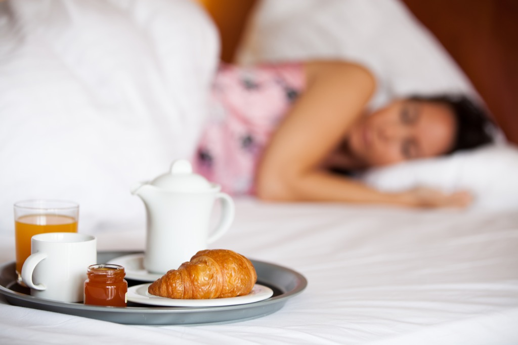 coffee nap happy and energized woman in bed