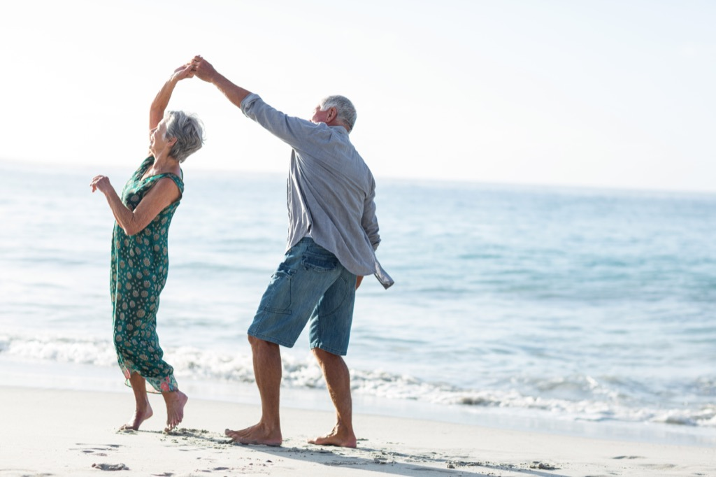 elderly couple on beach marriage last forever