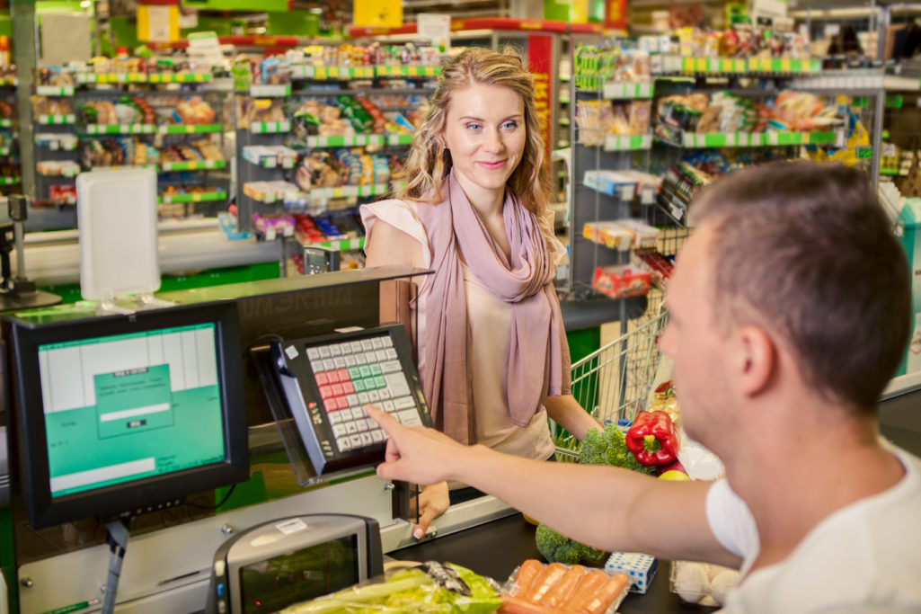Woman Checking Out Grocery Shopping Mistakes