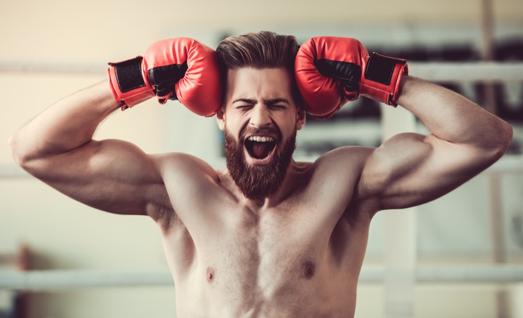 Man showing stress at the gym