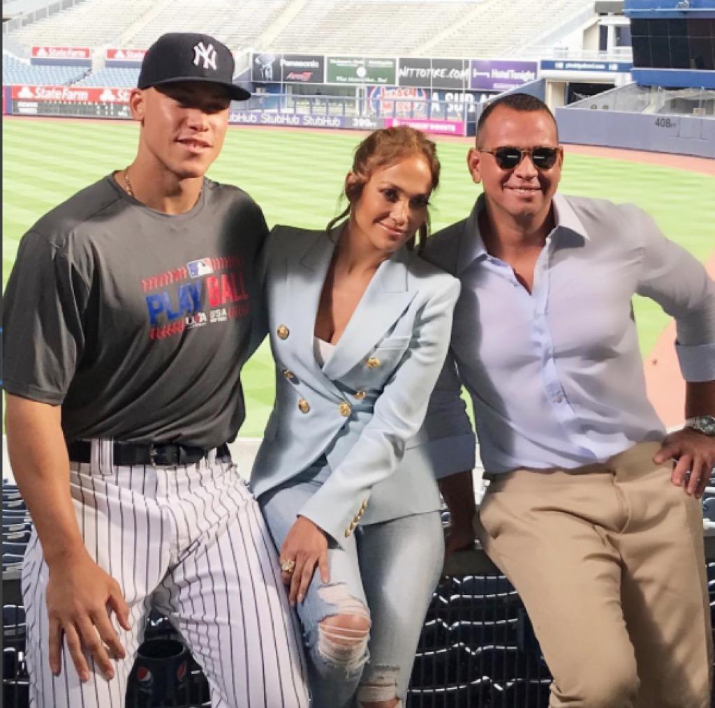 Alex Rodrigues and Jennifer Lopez at a baseball game.
