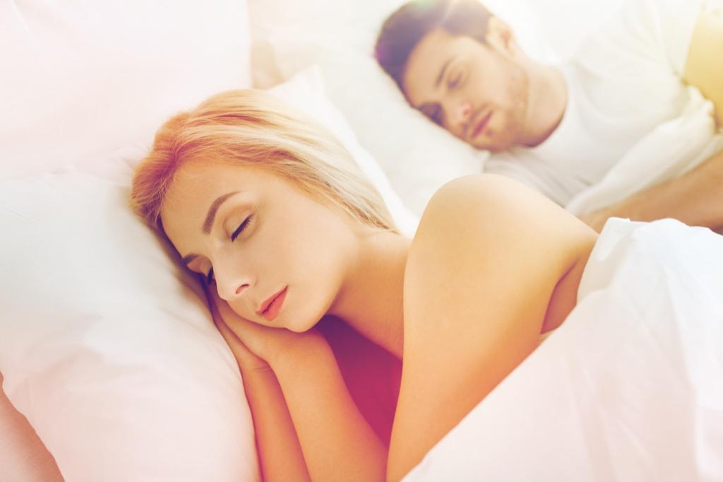 Couple sleeps in, maximizing body clock.