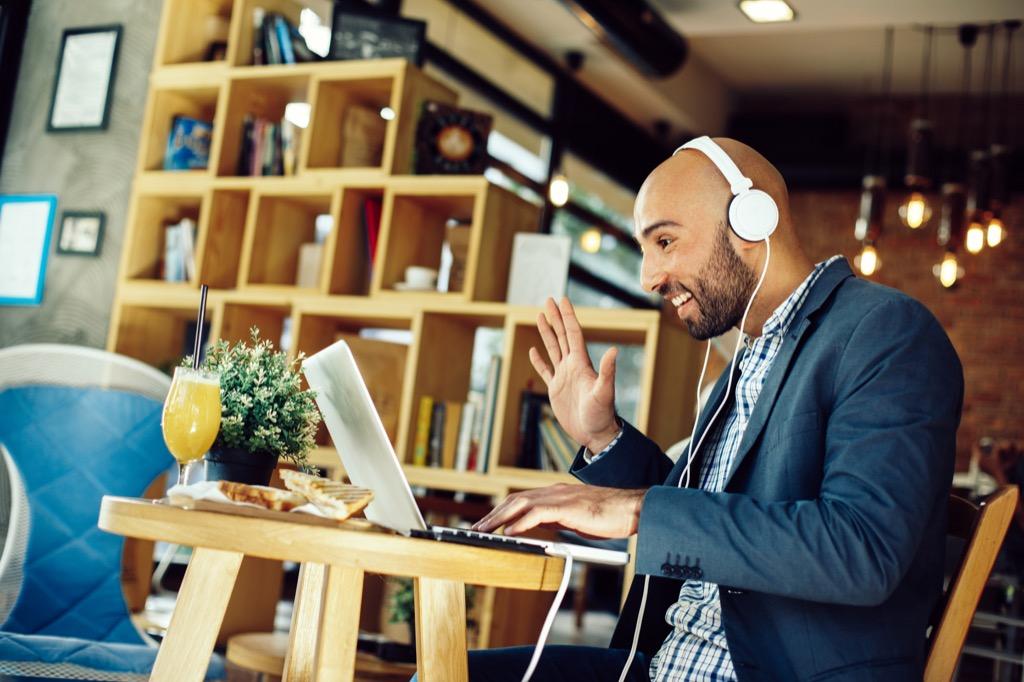 man in cafe on laptop skype facetime long-distance relationships