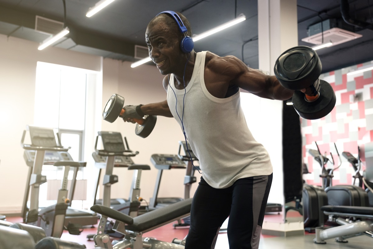 Man Listening to Music with Headphones at the Gym Healthy Man