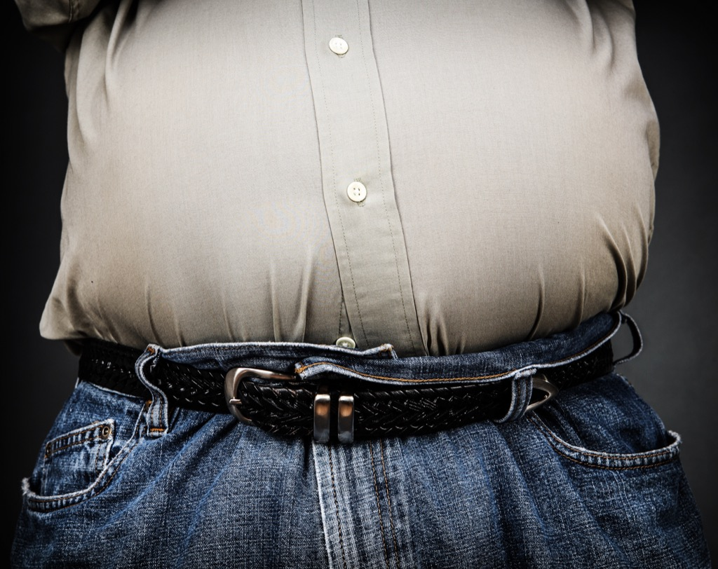 man with bulging stomach, ways your body changes after 40