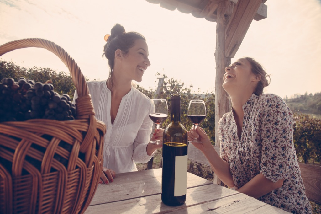 benefits of wine friends laughing