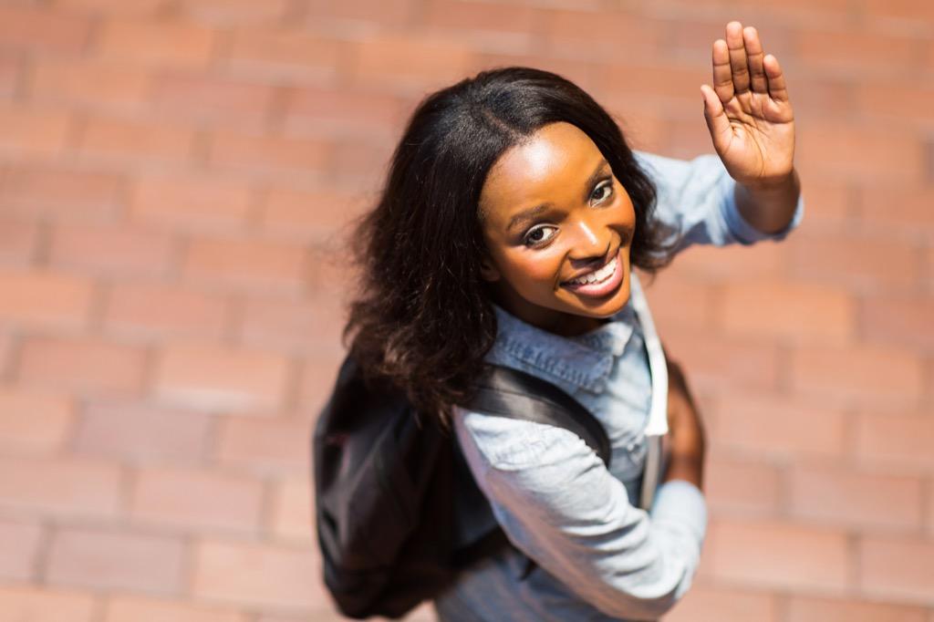 young black woman waving