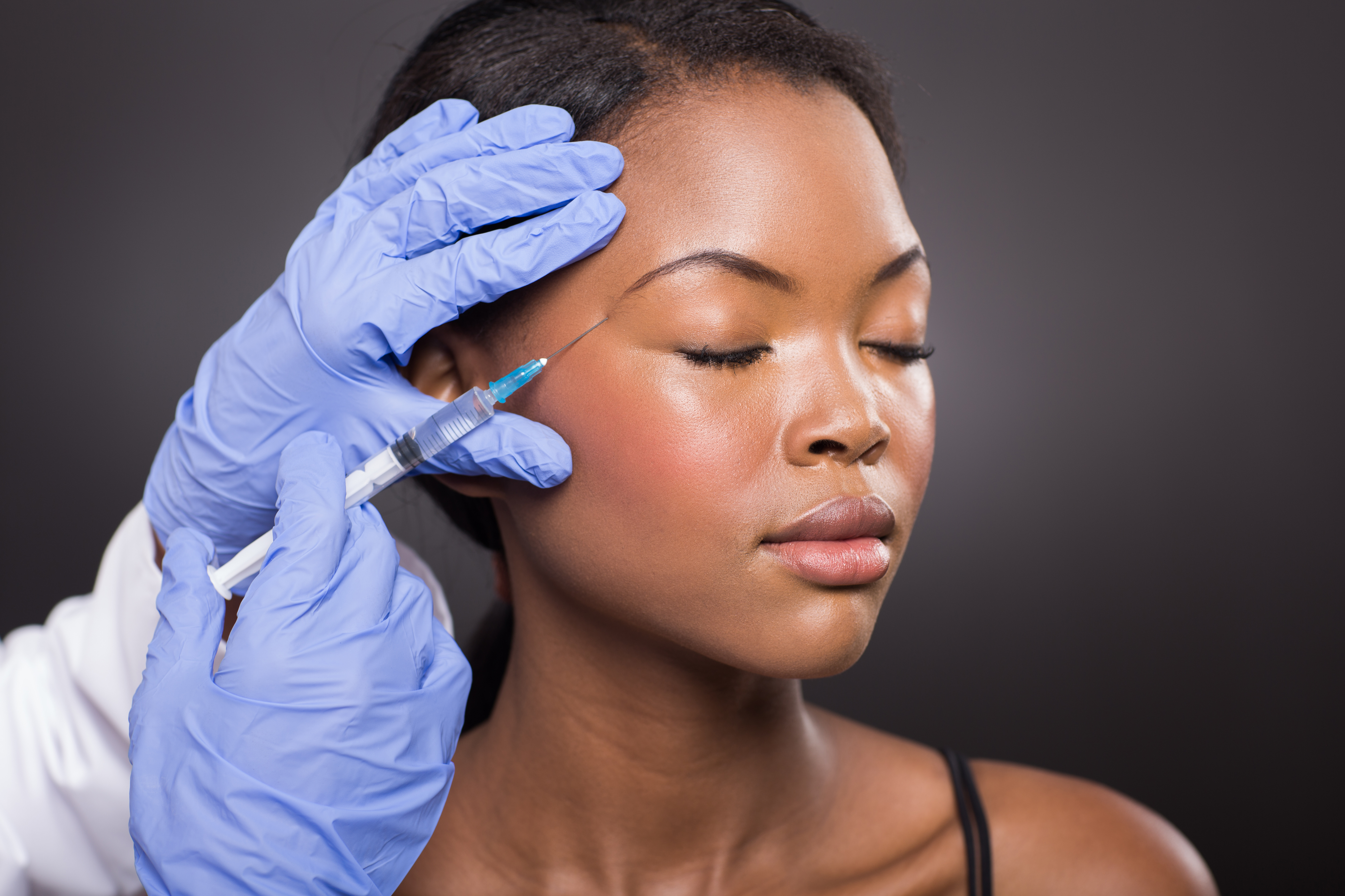 woman getting an injection for acne, healthy skin after 40
