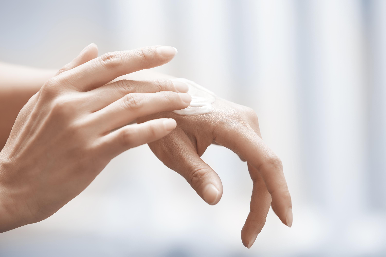 applying hand cream, healthy skin in your 40s