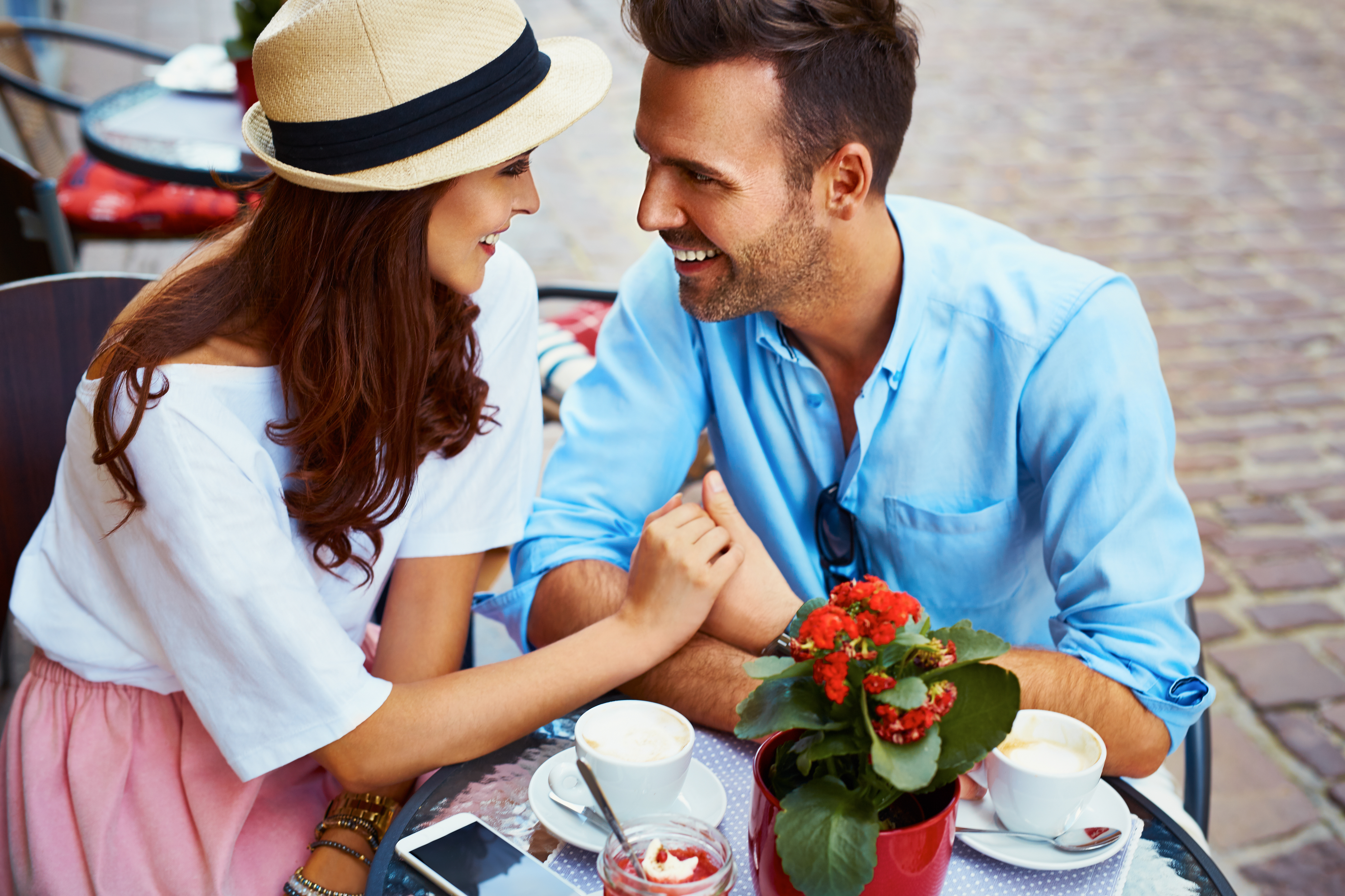 man and woman having a romantic date at sidewalk cafe, what he wants you to say