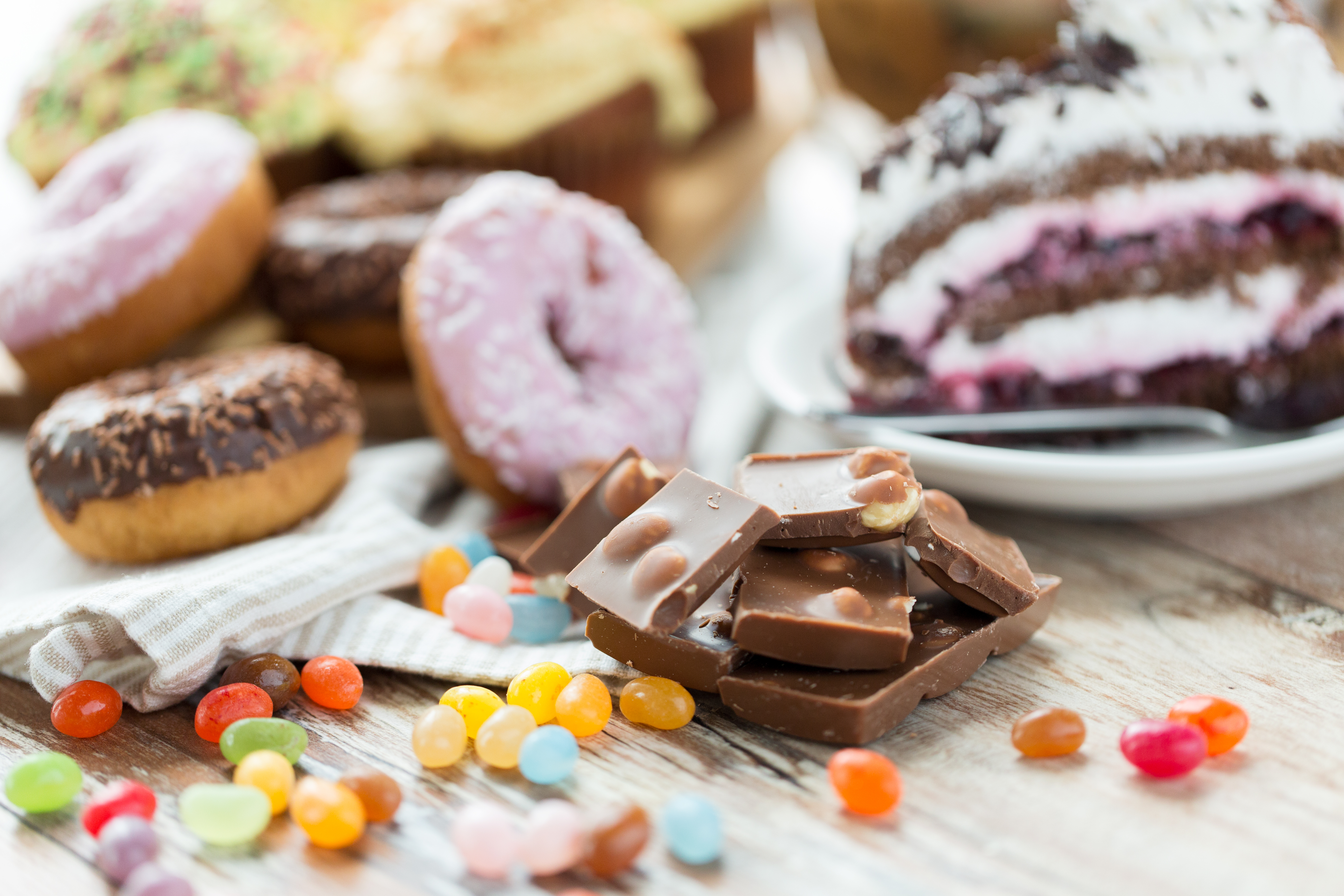 candy and sweets on a table, healthy skin after 40