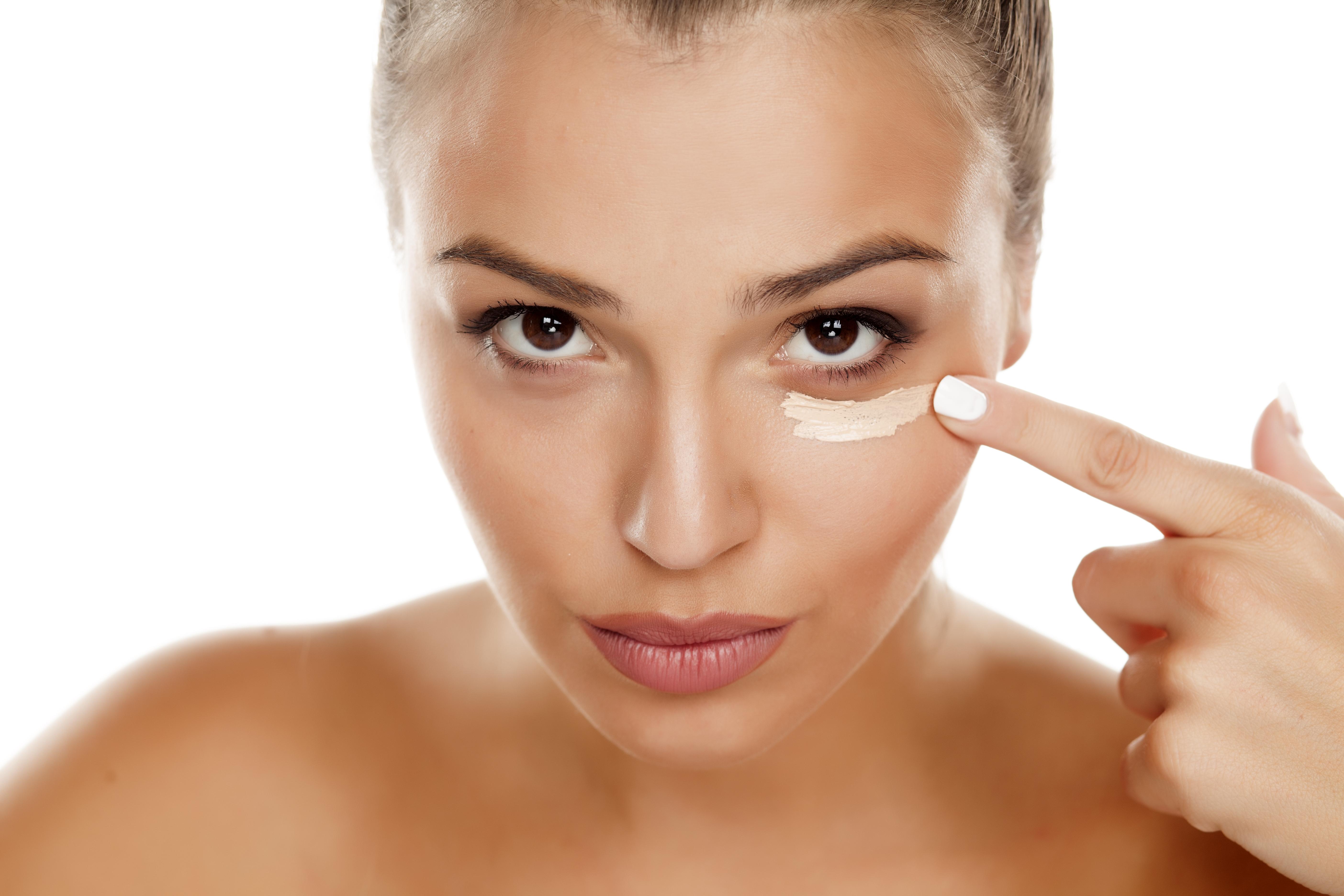 woman applying eye cream, healthy skin after 40