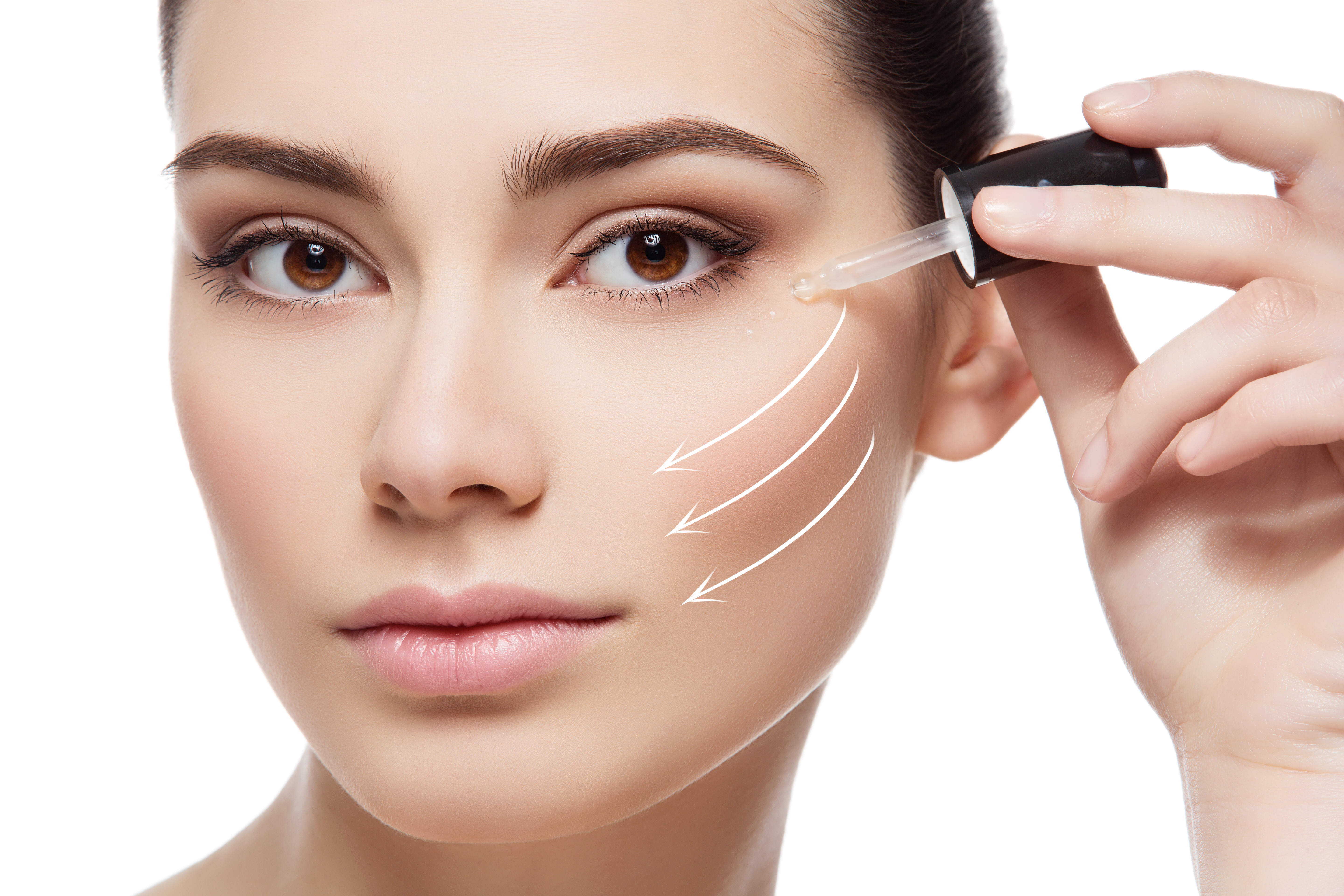 woman dotting her face with serum, healthy-skin-after-40-serum-1
