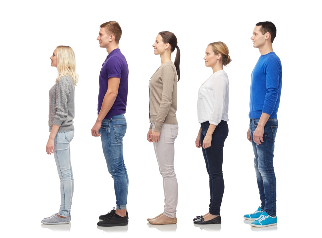 short and tall people standing in a line, ways your body changes after 40