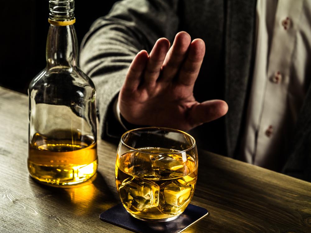 saying no to alcohol at a bar, healthy skin after 40