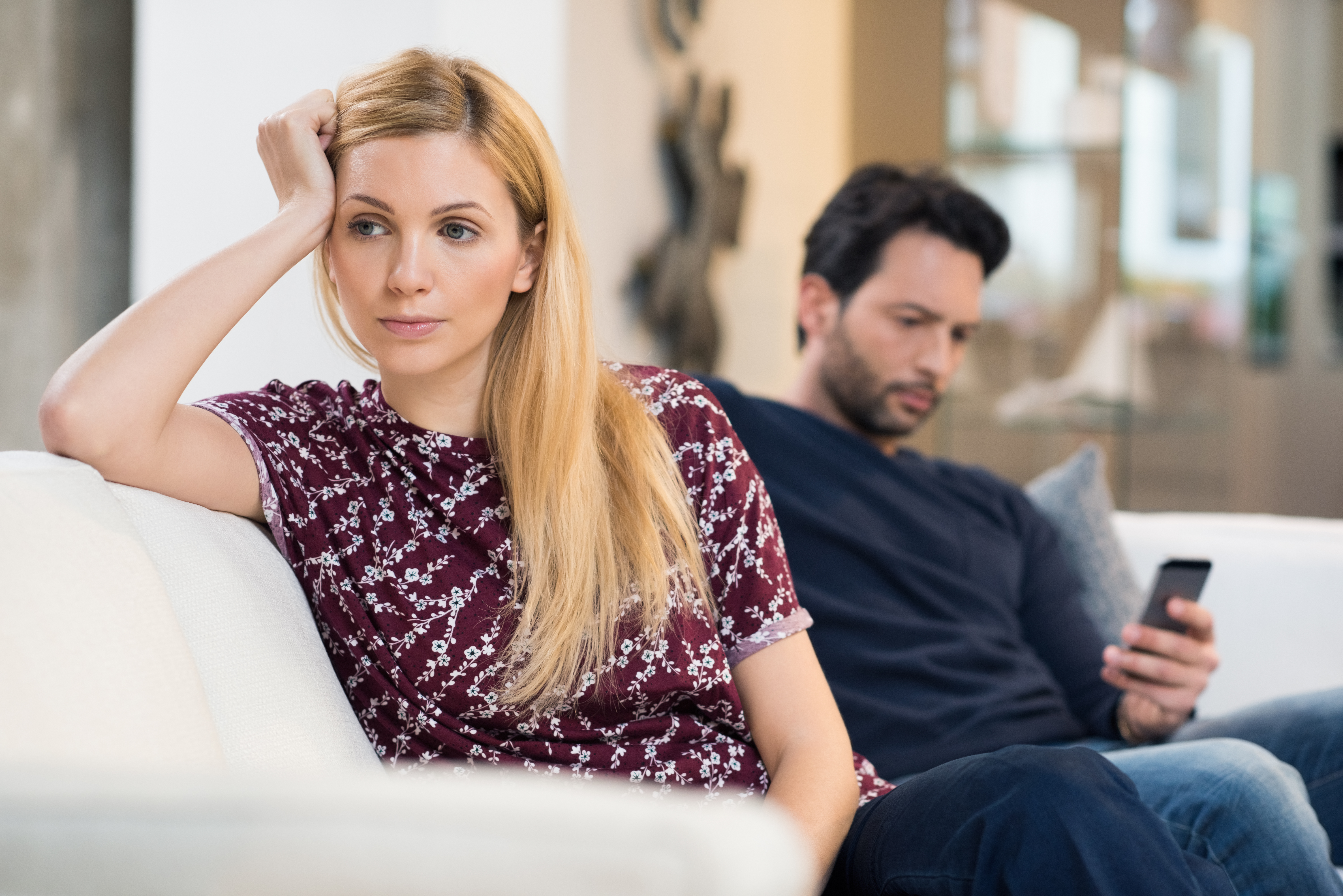 woman upset at husband on the couch, what he wants you to say