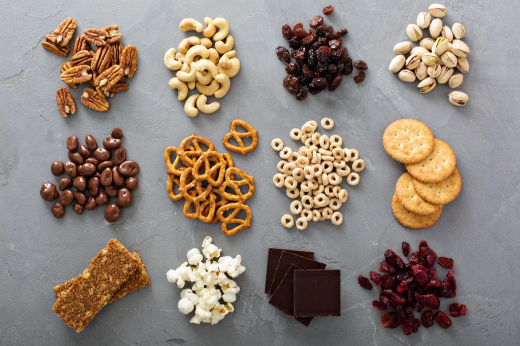 an assortment of nuts and pretzels and snacks