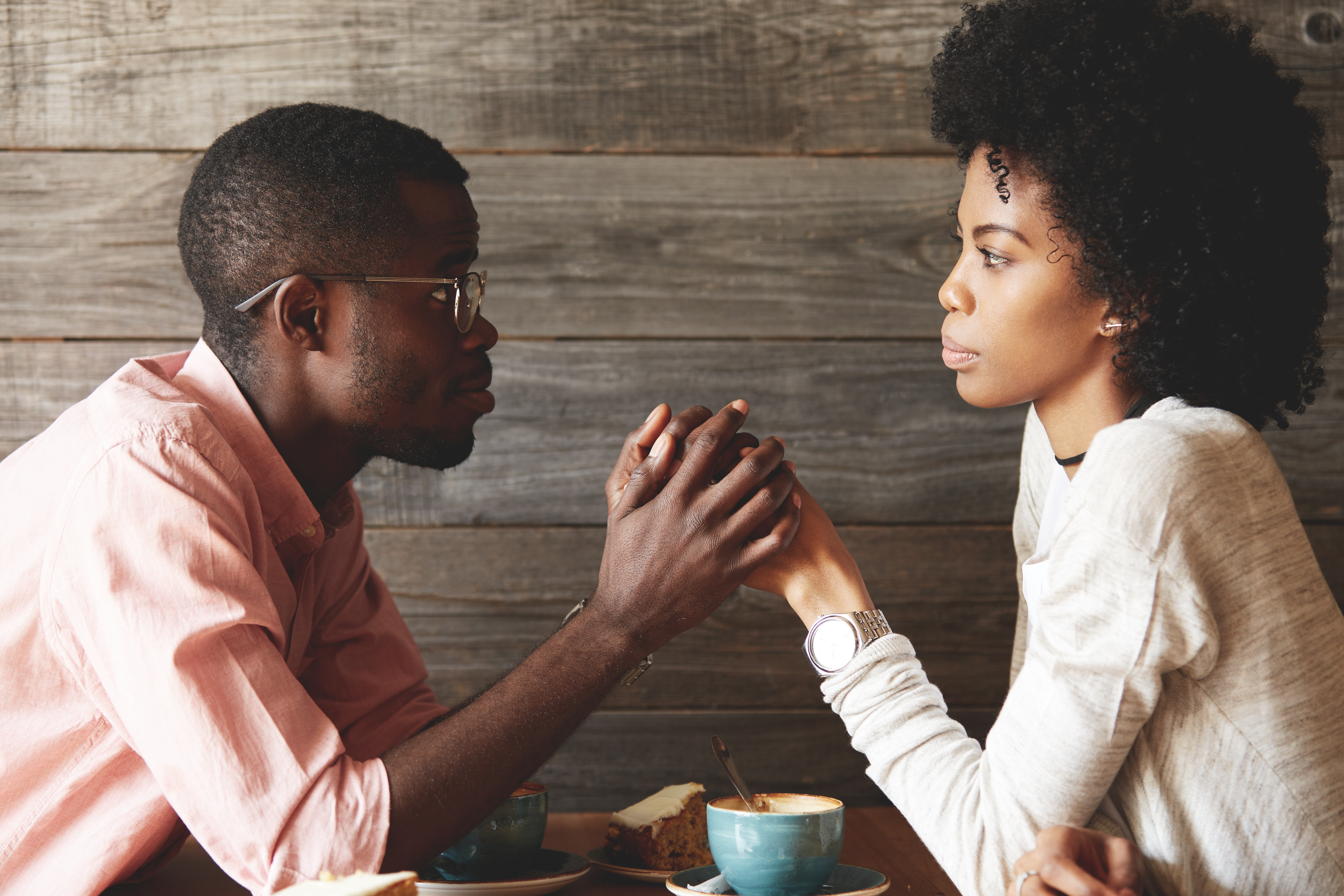 man and woman contemplating things at coffee, what he wants you to say