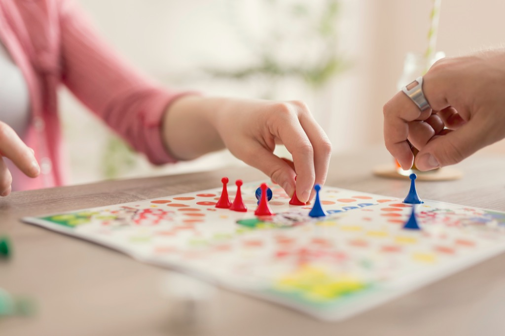 playing a board game is an easy way for couples to relax