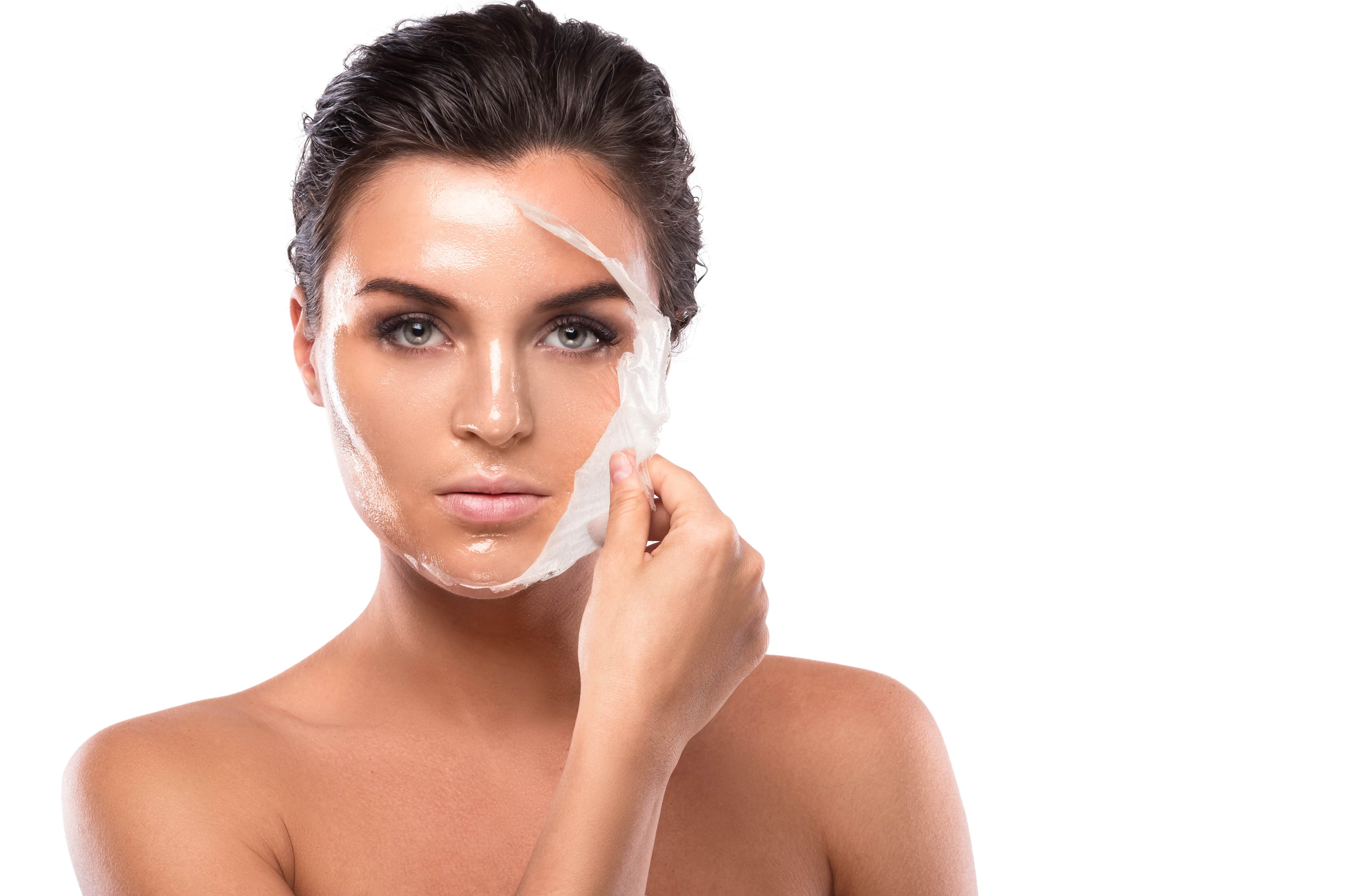 woman removing a face mask, healthy skin after 40