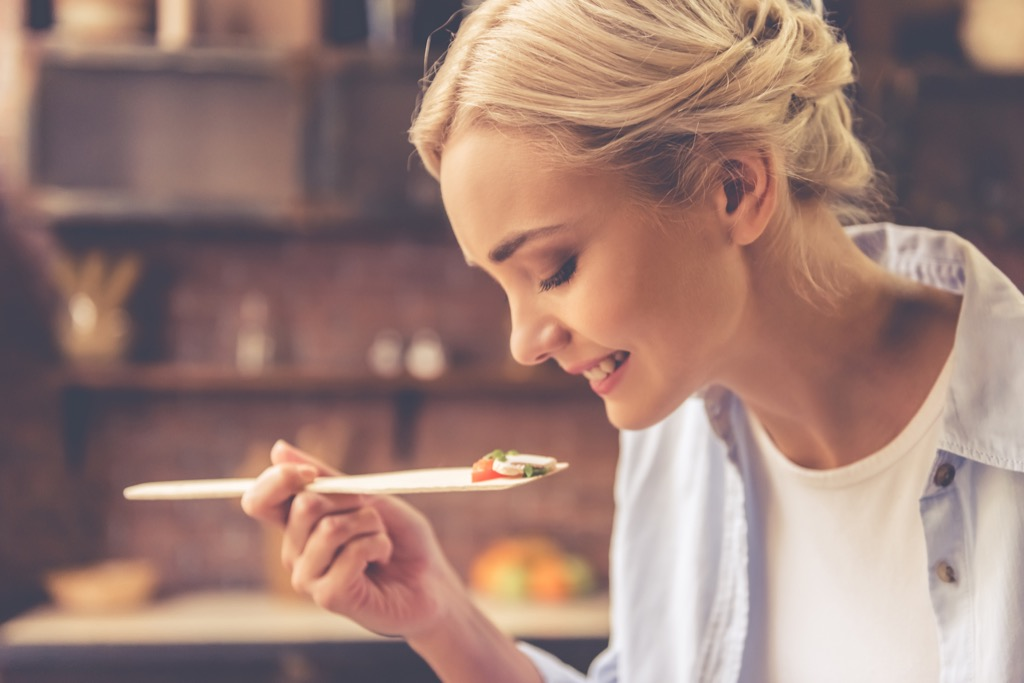 woman tasting food, ways your body changes after 40