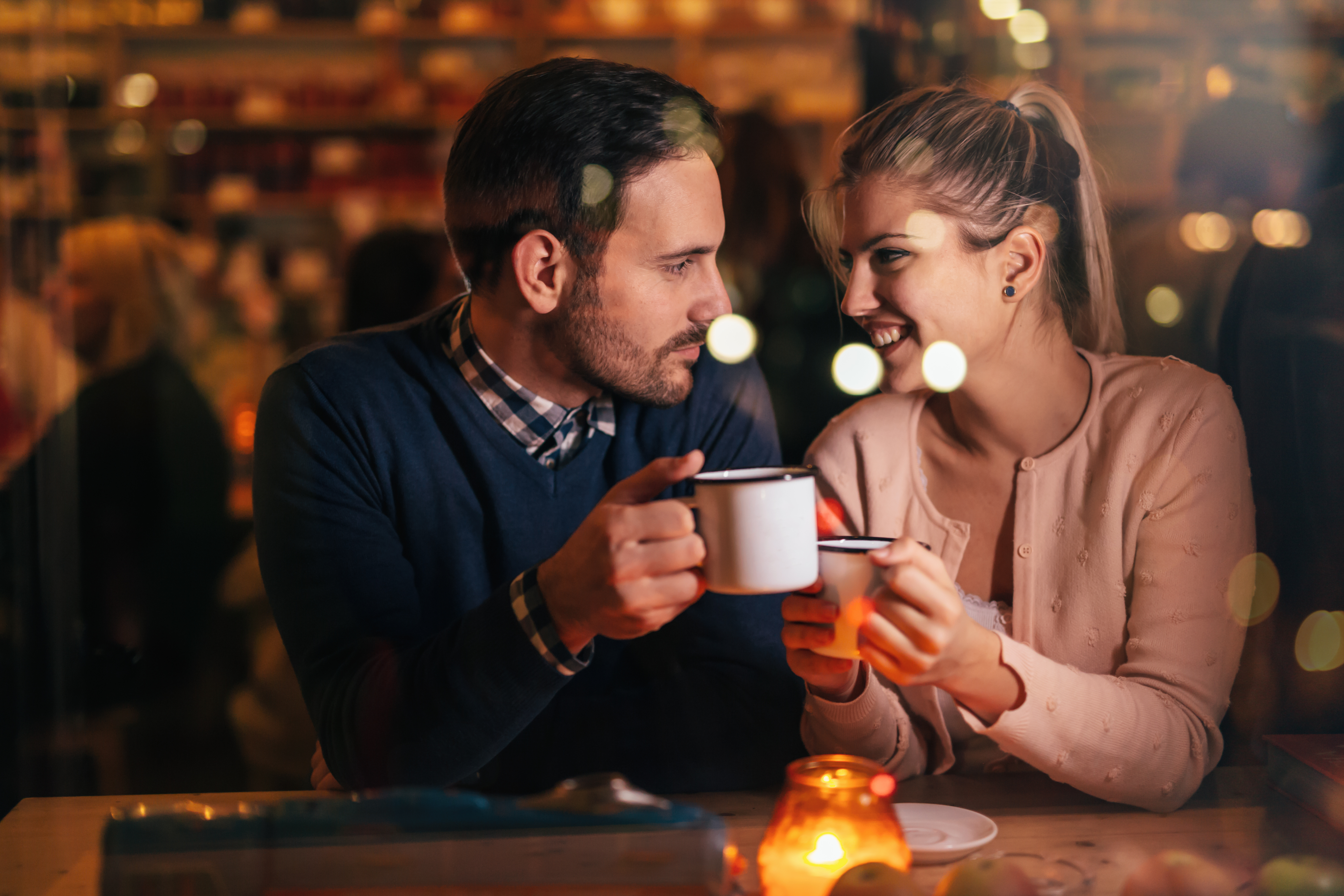 man and woman smiling over coffee, what he wants you to say