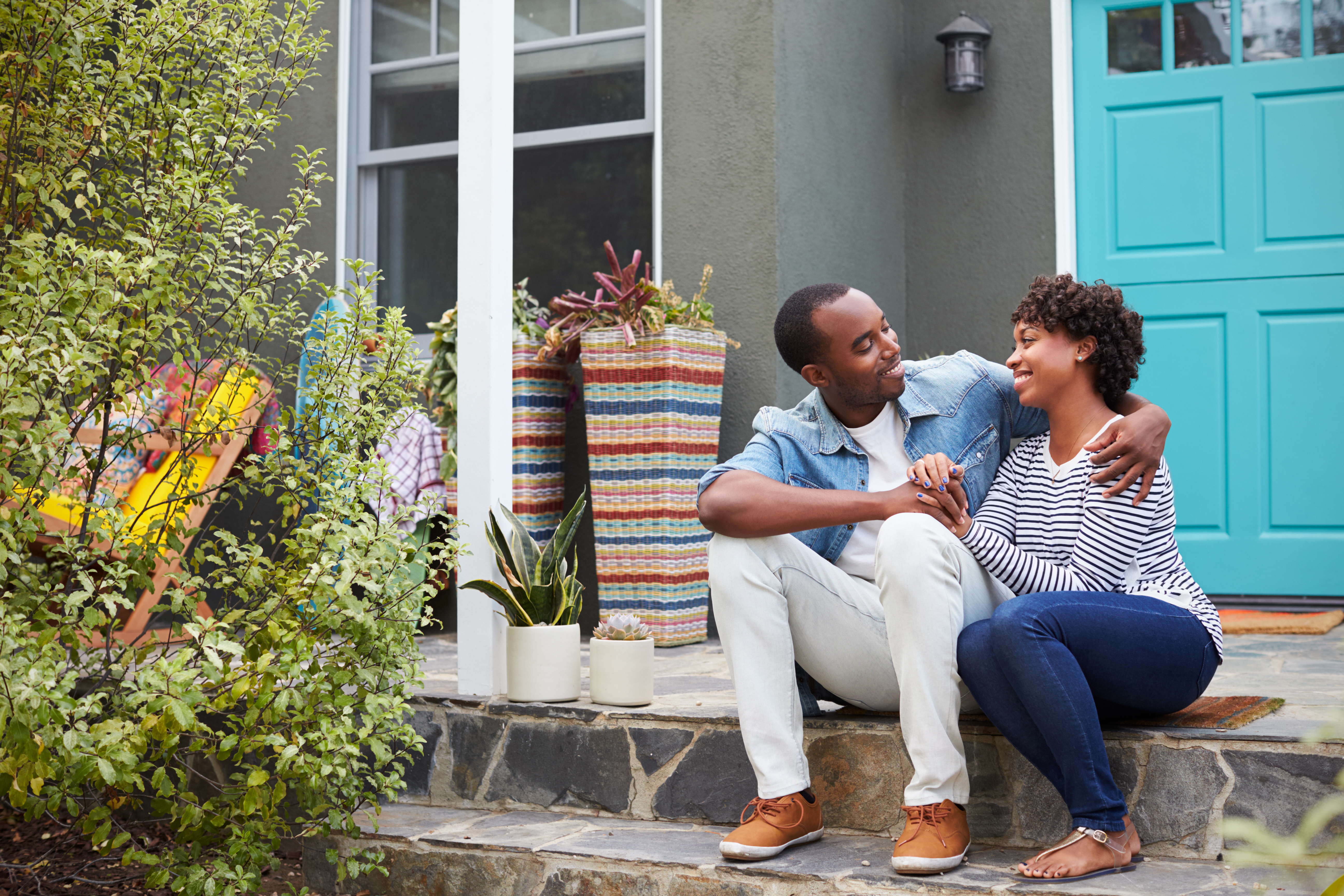 man and woman sitting on front stoop, what he wants you to say