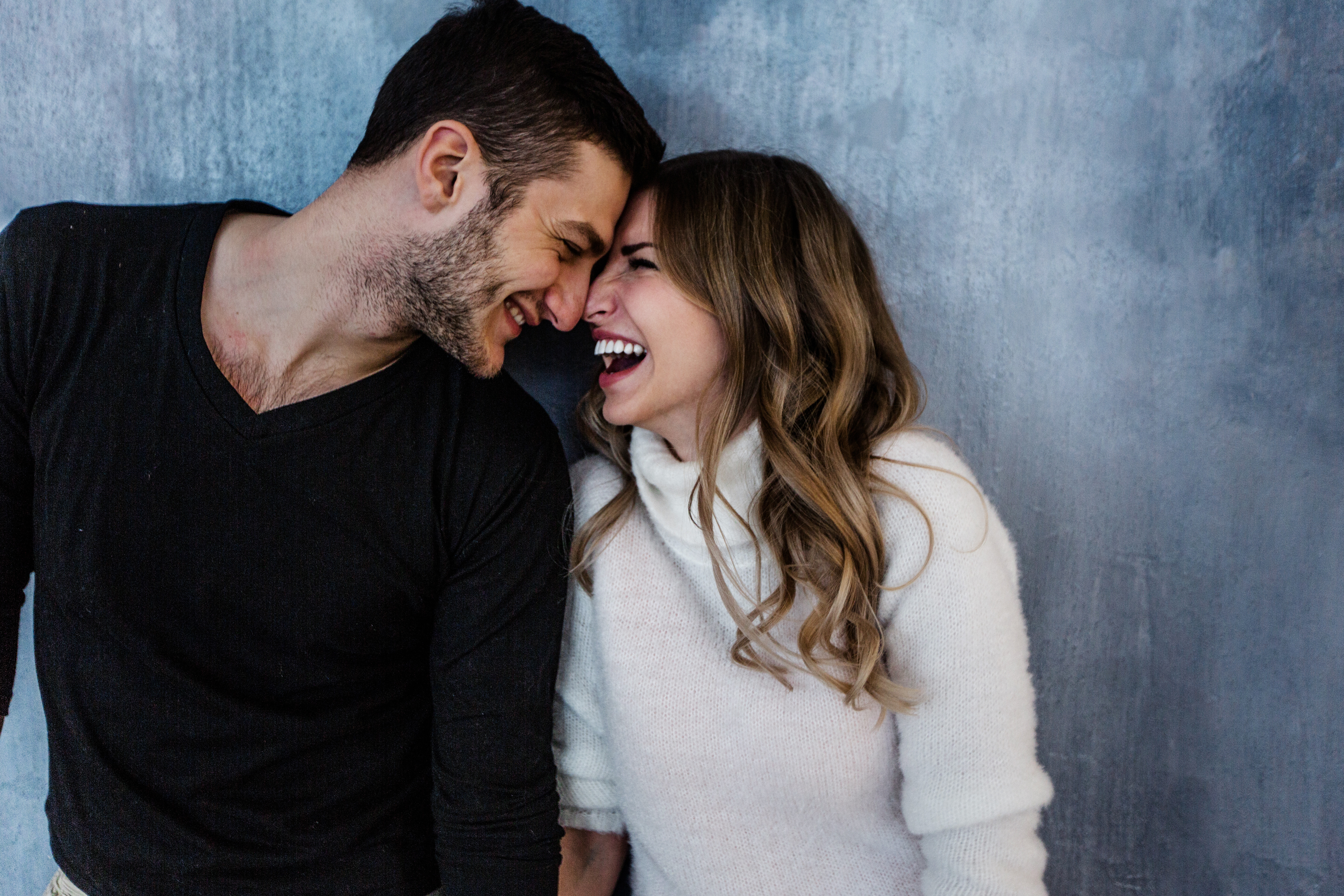 man and woman laughing together, what he wants you to say