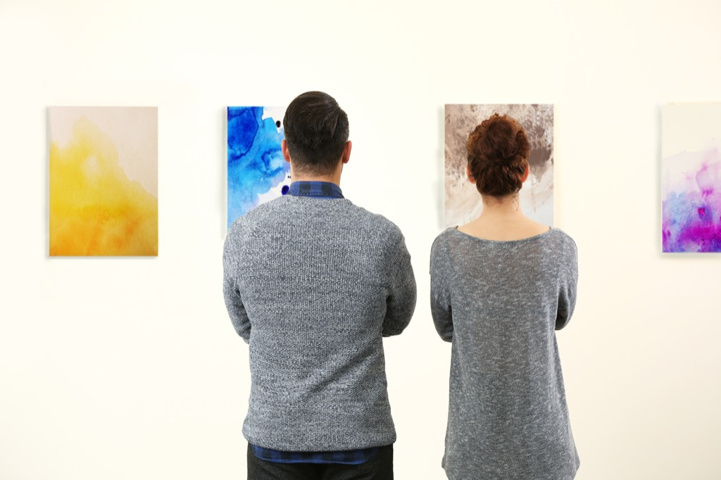 couple looking at art at museum