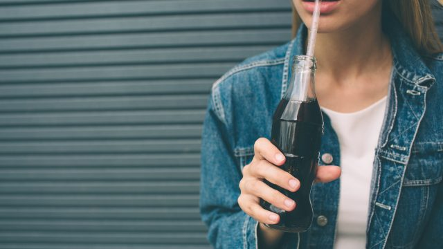 woman drinking soda, a bad habit after 40