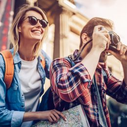 a woman and a man traveling and taking photos
