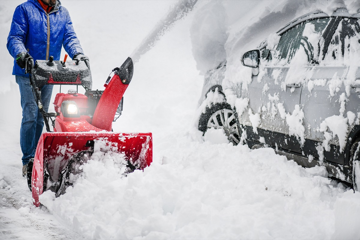Person Using a Snowblower in the Winter