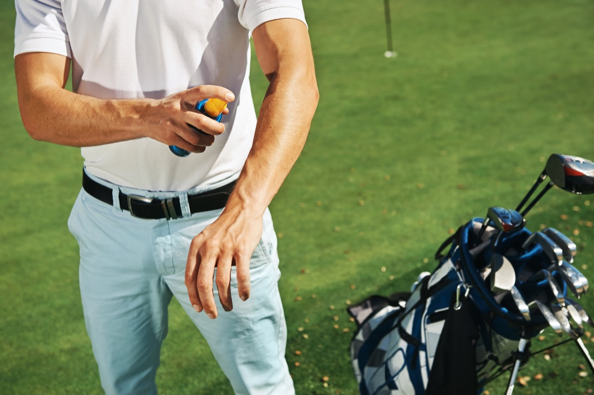 Man Putting on Sunscreen at the Golf Course Healthy Man