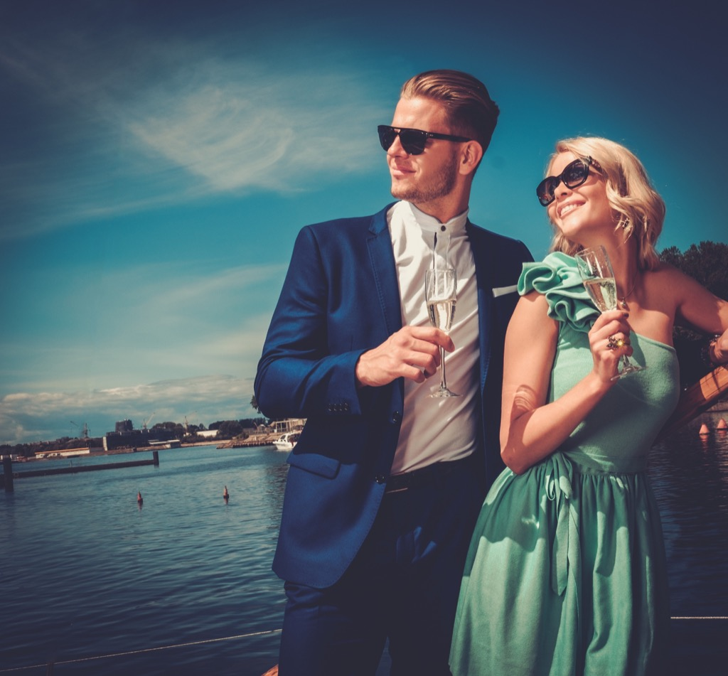 couple drinking champagne on boat advice you should ignore over 40