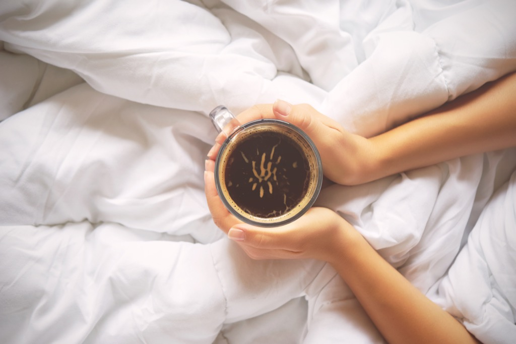 woman coffee nap bed