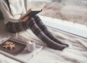 woman cozy reading in her bed stay sharp