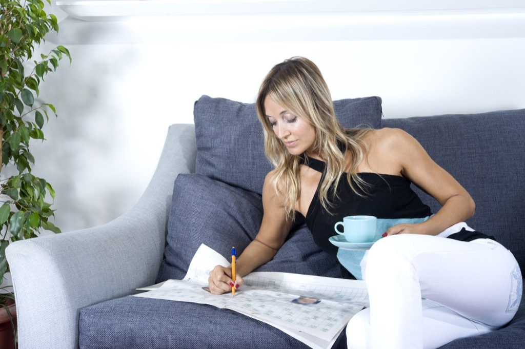 woman doing crossword stay sharp