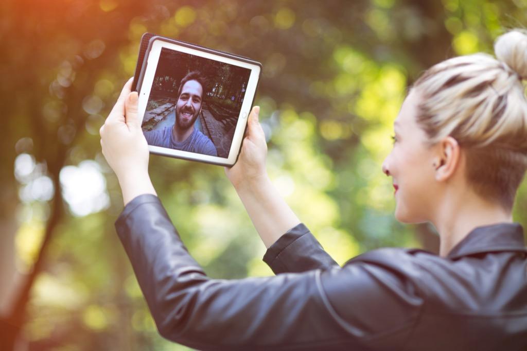 woman man ipad talking long-distance relationship advice