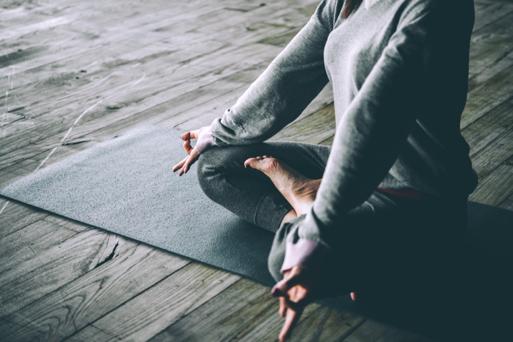 woman meditating stress stressed out