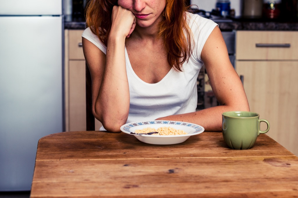 woman not eating her food stress stressed out